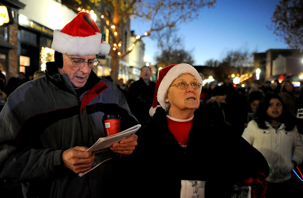 Description of . Bill & Jackie Hampton, Suisun City sing Christmas songs along with the Mobility from Travis Air Force Base during the 31st Annual Merriment on Main celebration on Tuesday, December 3, 2013. Joel Rosenbaum/JRosenbaum@TheReporter.com