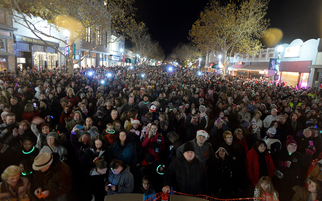 Description of . Flash bulbs go off throughout the crowd gathered on Main St. after the 2013 Vacaville Christmas Tree is lit during the 31st Merriment on Main celebration on Tuesday, December 3, 2013. Joel Rosenbaum/JRosenbaum@TheReporter.com