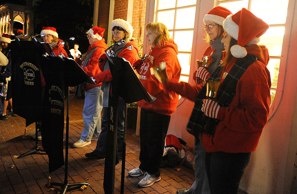 . Members of the Fellowship of the Ringers from Community Presbyterian Church entertain the crowd gathered in the courtyard of the Vacaville Museum on Tuesday, December 3, 2013 during Merriment on Main. Joel Rosenbaum/JRosenbaum@TheReporter.com
