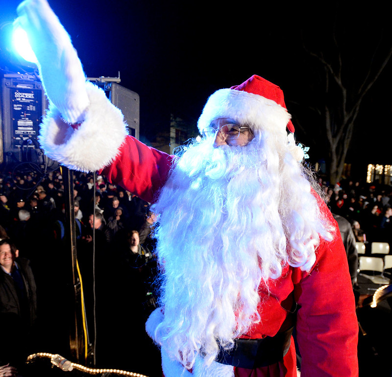 . Santa Claus responds to the cheers of the crowd as he makes his appearance on stage during the 31st annual Merriment on Main celebration Tuesday. Joel Rosenbaum/JRosenbaum@TheReporter.com